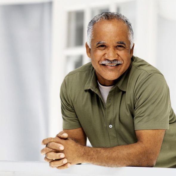 gray haired man, relaxed with a beautiful smile